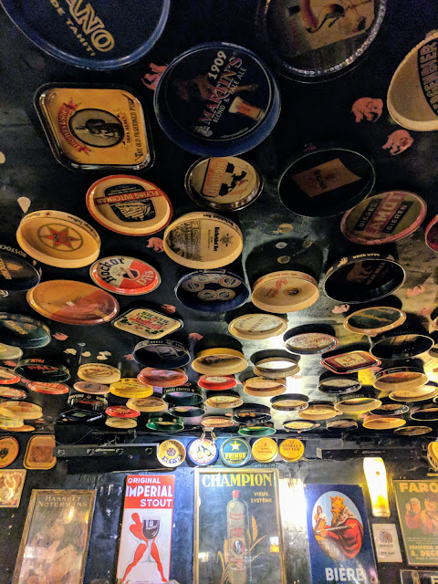 Trays on the ceiling at Delirium Cafe on a 4 hour layover in Brussels