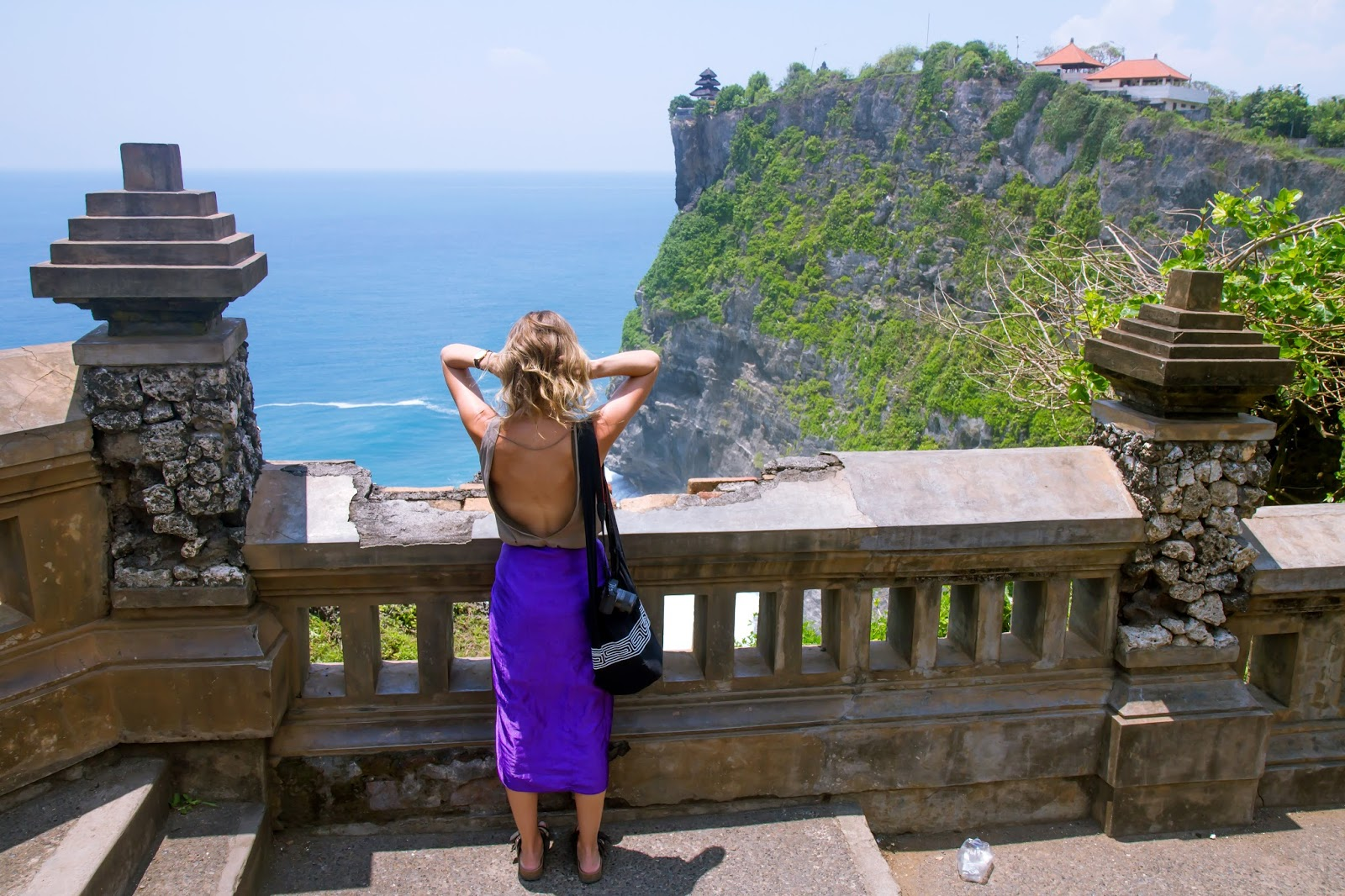 travel blogger, Alison Hutchinson, at Uluwatu Temple in Bali, Indonesia