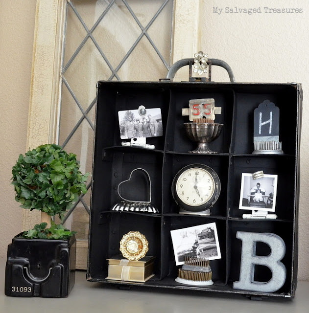 turn an old carrying case into a display shelf