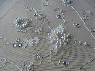 Embroidered dress panel courtesy of Elizabeth Braun