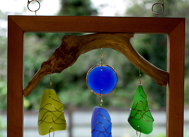 Detail image, framed driftwood with glass suncatcher