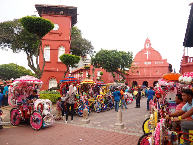 Clocktower, church and trishaws at the Dutch Square, Melaka, Malaysia