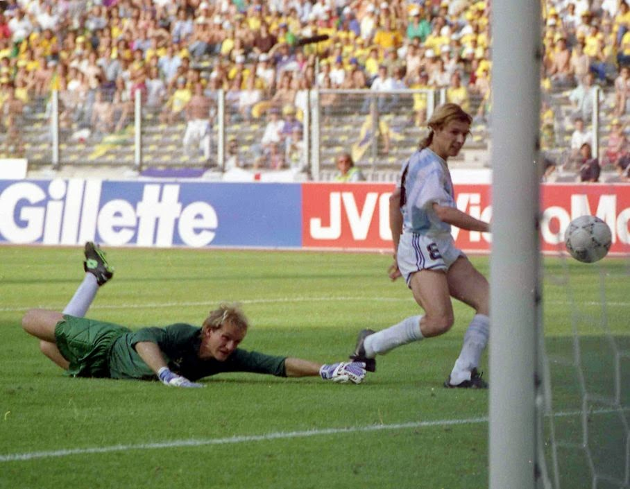 In this June 24, 1990 file photo, Argentina's Claudio Caniggia, right, scores, as the Brazilian goalkeeper Claudio Taffarel watches helplessly, during the World Cup second round soccer match, in Turin, Italy. On this day: Against the run of play, Argentina beats rival Brazil 1-0 to progress to the quarterfinals.
