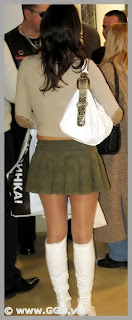 Girl in mini skirt and white boots