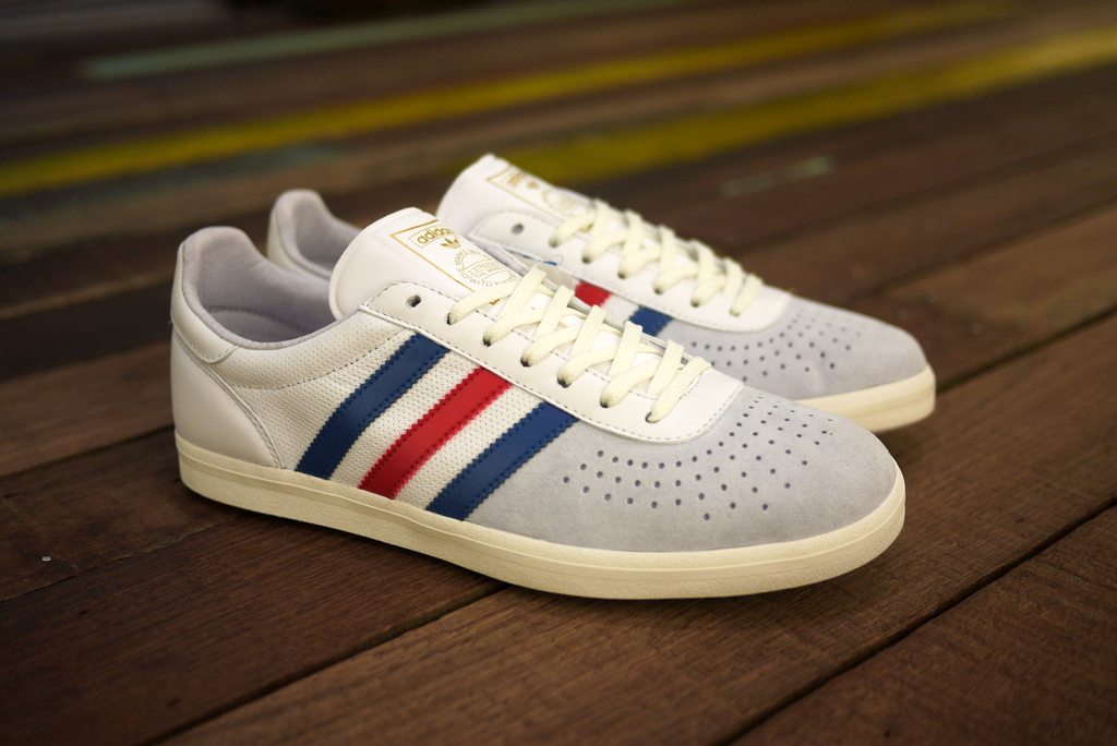 cheap for discount e1e69 b0a84 ... Trimm-Trab silhouette. It also features a classic football styled  textured tongue, gold Muchen lettering on the coloured three stripes, gold  Trefoil ...