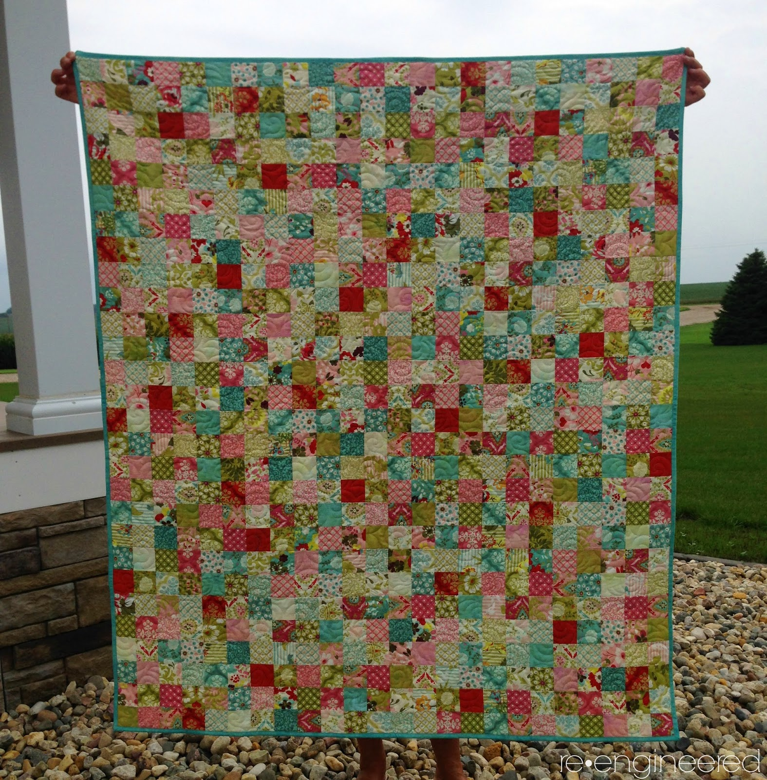 http://www.re-engineered.blogspot.com/2014/10/postage-stamp-baby-quilt.html