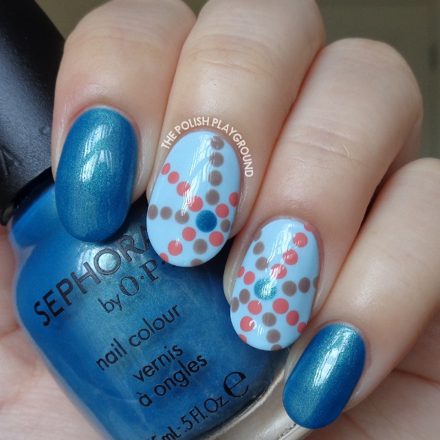 Blue with Starburst Inspired Dotting Pattern Nail Art