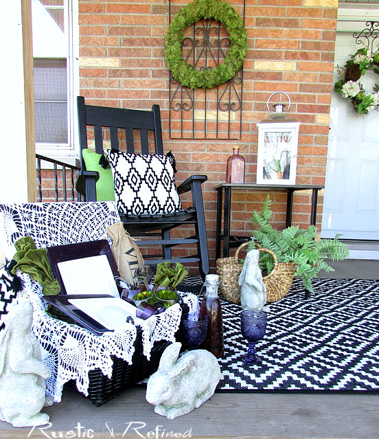 Farmhouse style decorating on the porch to welcome guests.