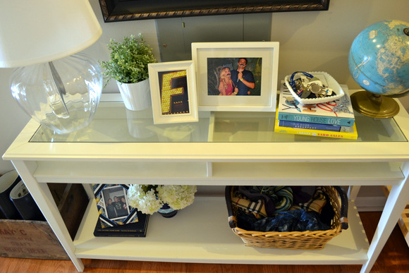 White Ikea Table in Entryway Books Keys Frames