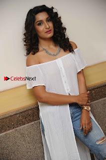 Kannada Model Actress Krishi Thapanda Stills in Ripped Jeans at Eradu Kanasu Movie Press Meet  0005.jpg