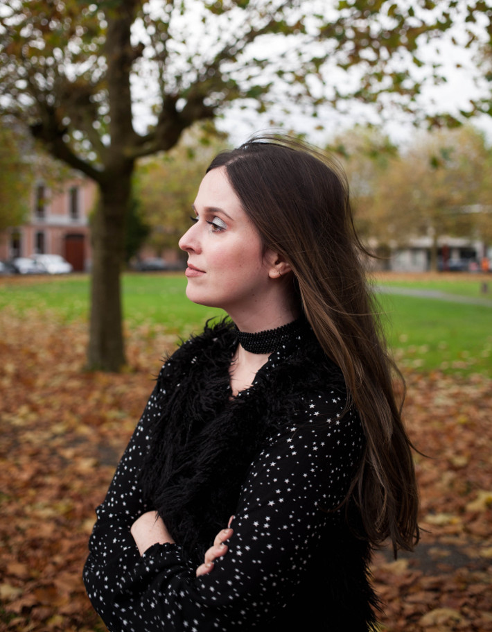 Outfit: all black outfit with star print blouse and shaggy faux fur vest