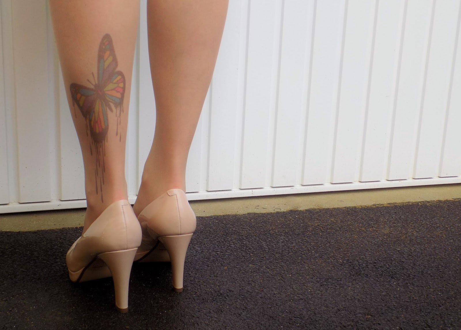 Butterfly tattoo tights and nude shoes