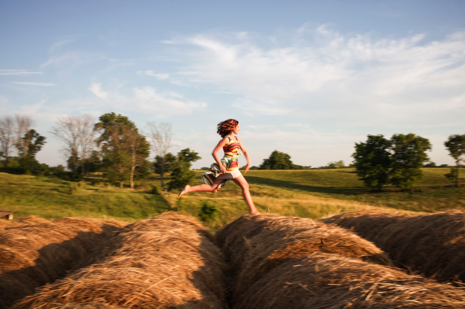 Amy West Running on Hay Bales