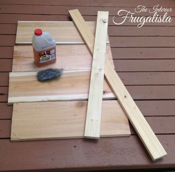 How to build a fun scrap wood fire pit subway sign for a backyard fence with free printable, and how to age the boards to look like weathered wood.