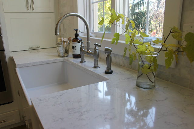 LG Viatera-quartz-Minuet-countertop-white-kitchen-farmhouse-sink-bridge-faucet