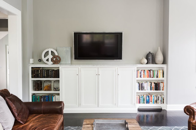 White built-ins in a modern farmhouse great room on Hello Lovely Studio