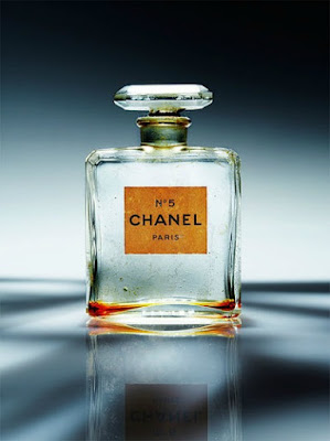 Bottle of Vintage Chanel No. 5 parfum displayed on blue cloth