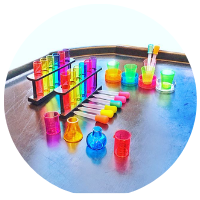 potion making tuff tray with potion bottles, pipettes, rainbow test tubes