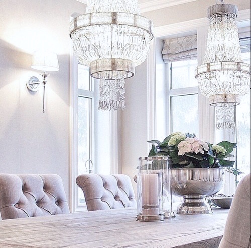 chandeliers + blush pink + living area