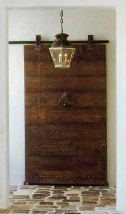 Antique Wood Door on Barndoor Hardware via Chateau Domingue as seen on linenandlavender.net