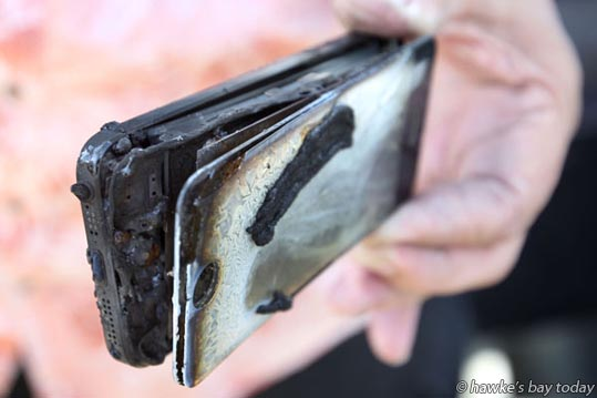 Darryl Whiting, Taradale, Napier, left an iPhone 5 mobile phone, cellphone (which had a flat battery) in the back seat of his car. He returned to his car to find it full of smoke, seriously damaged, and his phone burned out. photograph