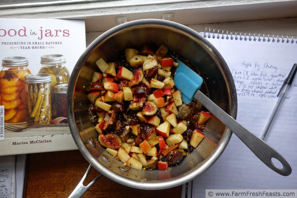 image of a saucepan with ingredients to make Apple Fig Chutney as well as the inspiring cookbook, Food in Jars by Marisa McClellan, and a notepad with recipe notes
