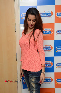 Deeksha Panth Pictures in Ripped Jeans at Radio City 91.1 FM  0033.jpg