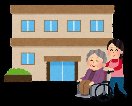 介護施設で車椅子に乗った女性を押す女性