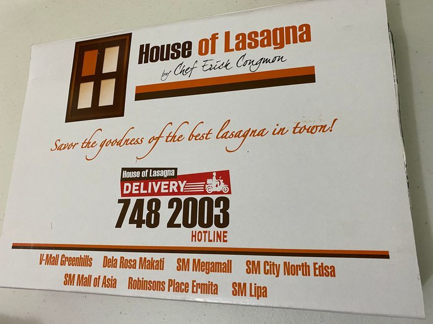 Baked lasagna in a secure box packaging from House of Lasagna