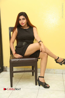 Tollywood Upcoming Actress Pooja Roshan Stills in Black Short Dress at Plus 1 Movie Trailer Launch  0309.JPG