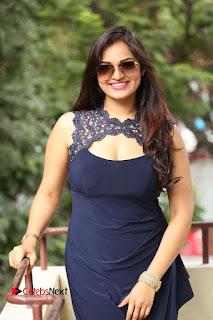 Actress Ashwini Pictures in Short Dress at Vinodam 100 Percent Press Meet  0168.JPG