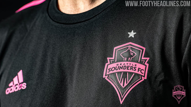 3d35db802 ... Sounders 2019 away jersey has a black base and combines it with pink  accents. The crest on the Seattle Sounders away shirt was recolored and  match the ...
