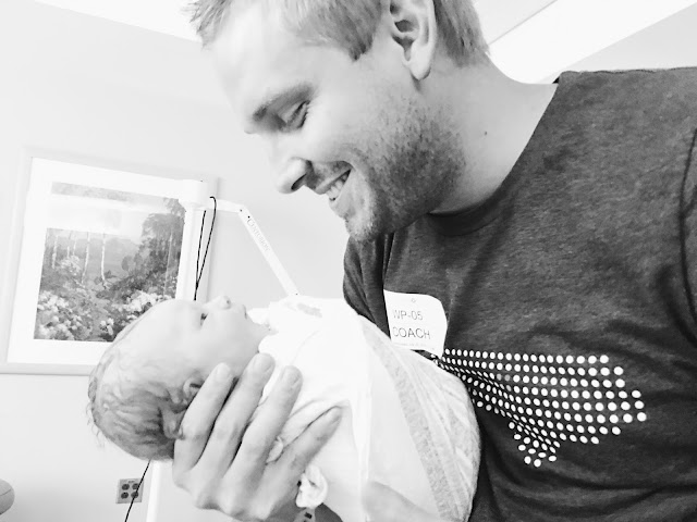 father-holding-his-new-baby