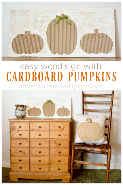 easy wood sign with cardboard pumpkins