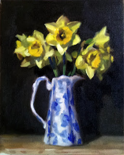 Oil painting of many yellow daffodils in a blue and white porcelain jug.