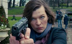 Milla Jovovich pointing a gun
