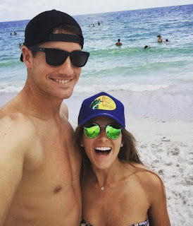 John with his girlfriend Madison having fun at the beach