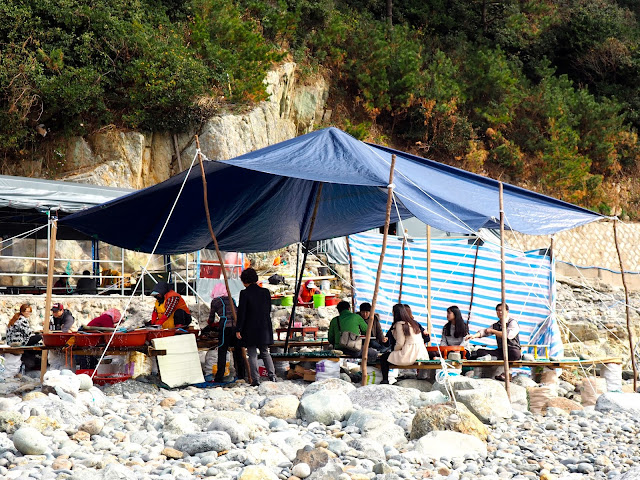 Seafood tent on pebble beach in Taejongdae Park, Busan, South Korea