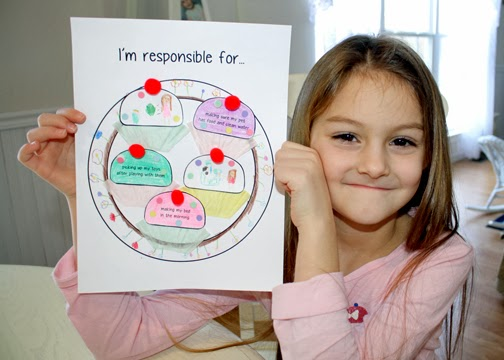 "Tessa made ""Responsibility Cupcakes"" to show things she is responsible for. On the blank cupcake toppers, she chose to draw that she is responsible for throwing away her candy wrappers and washing her hands to help keep herself and others healthy. She decorated her cupcakes with pom-pom cherries and confetti paper sprinkles."