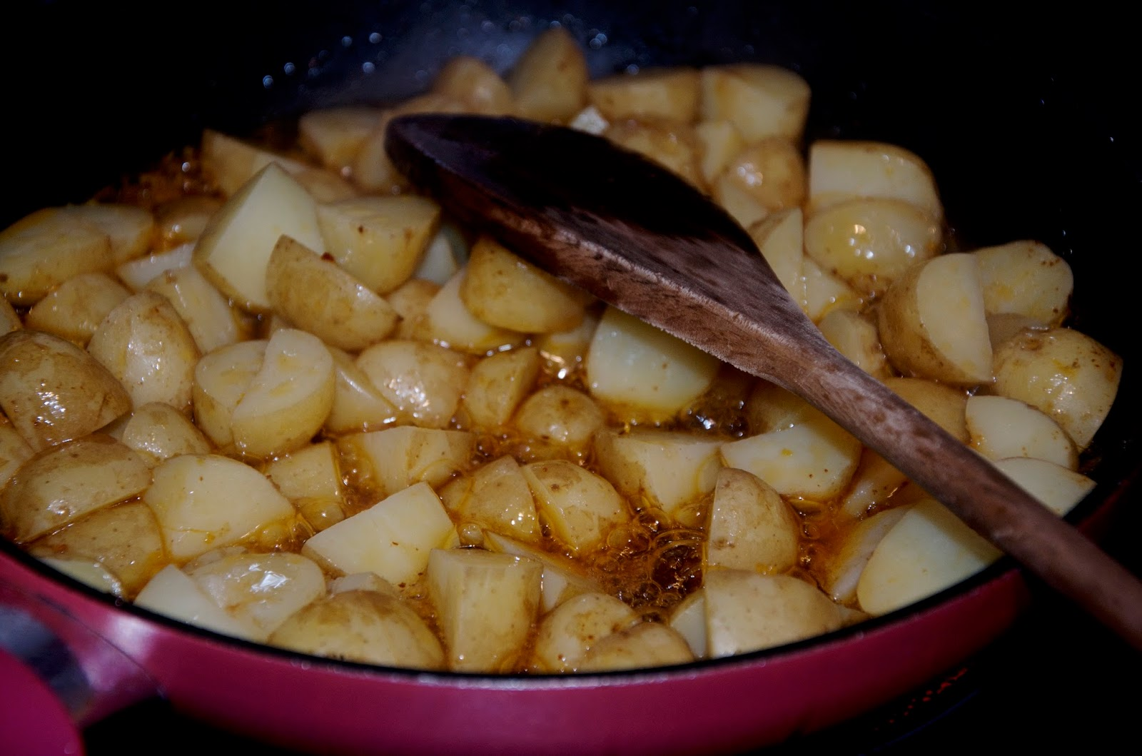 potatos in a pink frying pan