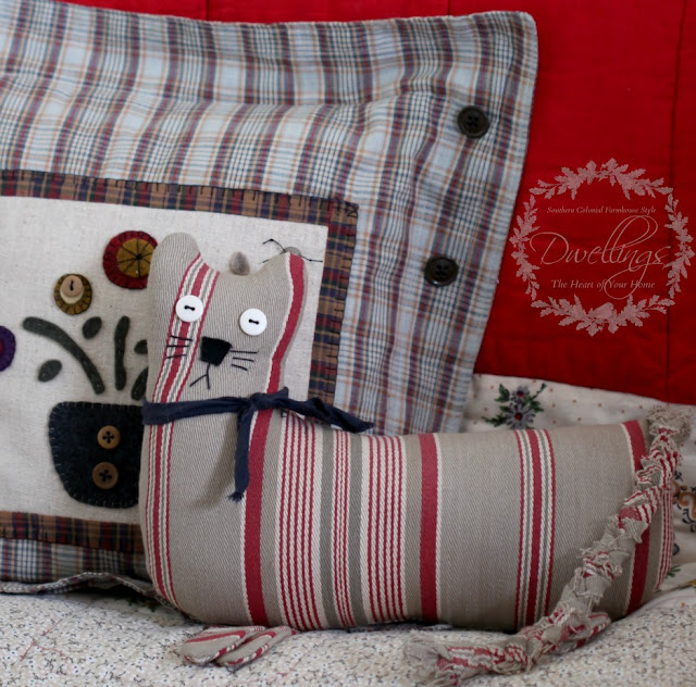 Colonial farmhouse guest room with handmade quilts, pillows and a ticking kitty too.