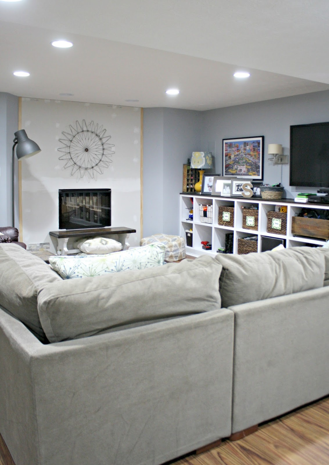 basement family room with DIY fireplace