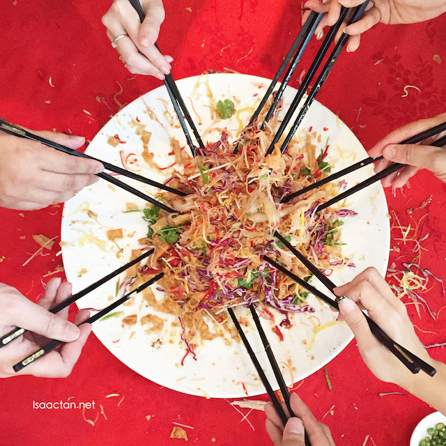 An integral part of any CNY meal would be the tossing of the Yee Sang