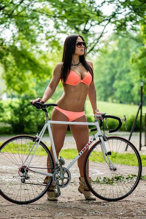 Photo of sexy woman riding a bike