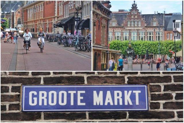 Mujeres en bicicleta las inmediaciones de Grote Markt, Grote Markt, Señal calle Grotemarkt