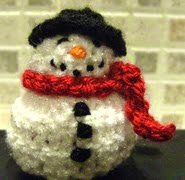 http://www.ravelry.com/patterns/library/snowman-chocolate-cover-decoration