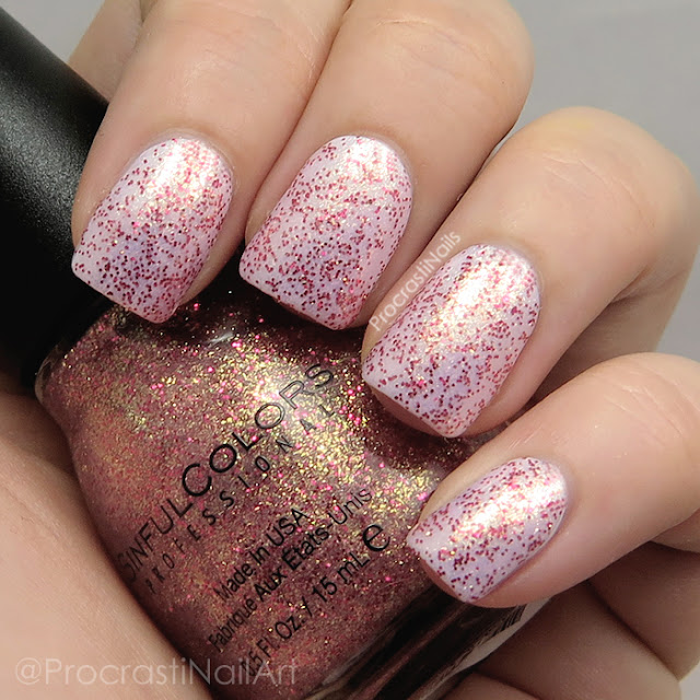 Swatch of Sinful Colors Gilded which is a pink and gold shimmer polish with red glitter