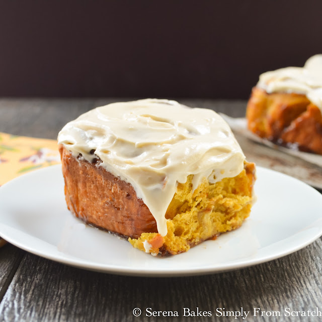Pumpkin Cinnamon Rolls With Maple Cream Cheese Frosting are so good that even if you normally just eat the center you'll enjoy the whole roll! serenabakessimplyfromscratch.com