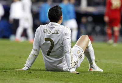 Cristiano Ronaldo sat on the grass after the defeat against Bayern