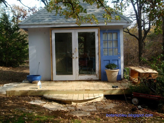 Botanic Bleu garden shed beginnings with new entry deck